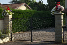 Iron gate, entrance to a front yard Royalty Free Stock Photography