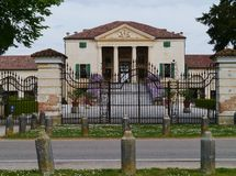 The iron gate in front of the Emo villa Stock Image