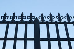 Iron gate in front of the sky stock image