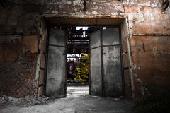 Iron gate in an industrial building Stock Images