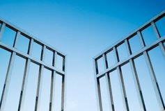 Iron gate open to the sky. Concept of freedom royalty free stock photo