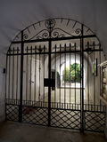 Iron gate protecting private home Stock Photos