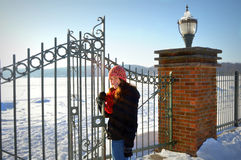 Iron Gate with Teenage Girl Winter Stock Photo