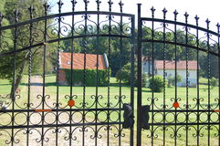 Iron gate to the entrance of cottages Royalty Free Stock Photography
