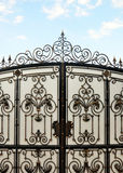 Iron gate with wrought ornament Royalty Free Stock Image