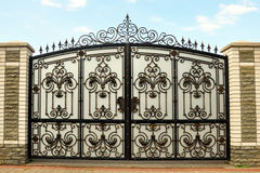 Iron gate with wrought ornament on it Royalty Free Stock Images