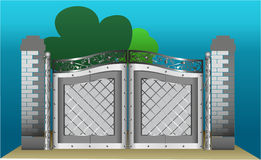 Iron gates with blue sky and green trees Stock Photo