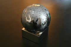 Iron globe puzzle. On the desk Royalty Free Stock Photos