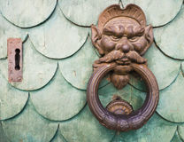 Iron goblin face doorknocker Stock Images