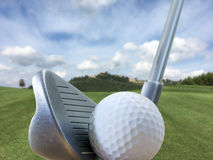 Iron, a golf ball in a beautiful golf course Royalty Free Stock Images
