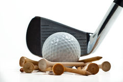Iron with golf balls and tee Royalty Free Stock Photos