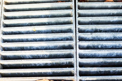 Iron grate for sewers on the street2 Stock Photo