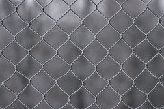 Iron grid in the snow royalty free stock images