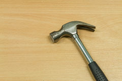 Iron hammer on wooden table Royalty Free Stock Photography