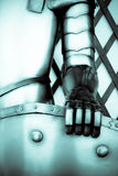 The iron hand of a knight. Holding a shield Royalty Free Stock Photo