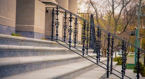 Iron hand rail and steps. Leading into a building stock image