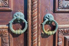 Iron handle. Church wooden door with an iron handle Stock Images