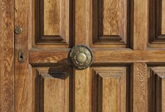 Iron handle and lock keyhole on old wooden door Stock Photo