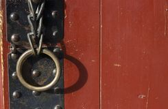 Iron handle with ring on an antique door close-up royalty free stock photography