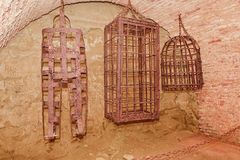 Iron hanging medieval torture cages. Medieval torture.  Stock Photo