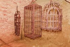 Iron hanging medieval torture cages. Medieval torture.  Royalty Free Stock Image