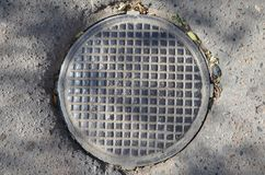An iron hatch with grid. This picture shows an iron hatch with grid stock photos