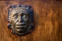 Iron head at the door of a colonial house Royalty Free Stock Photography