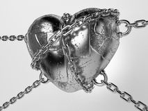 Iron heart. Rusty iron heart hung on chains Royalty Free Stock Images