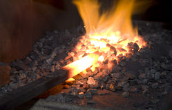 Iron in the hearth. Detail from smithy stock photography