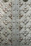 Iron heavy doors. Old iron heavy and shiny doors Royalty Free Stock Images