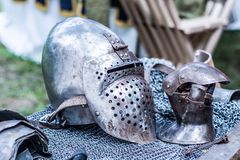 Iron helmet and protective metal glove of the medieval knight royalty free stock photography