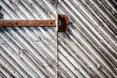 Iron hinge on door Stock Image