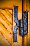 Iron hinge on an old wooden door stock photography