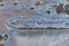 Iron hinge on the rusted door. Iron counter on the rusted door in the house Stock Images