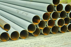 Iron hollow tubes. Hollow iron pipes on concrete floor Royalty Free Stock Photography