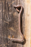 Iron hook on wood Stock Image