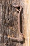 Iron hook on wood. Old iron hook on wood panel Stock Image