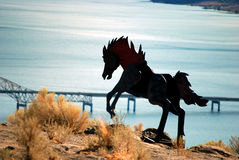 Iron Horse. Metal horse silhouette over fantastic scenery Stock Image
