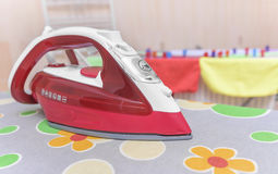 Iron on an ironing board. Royalty Free Stock Photo