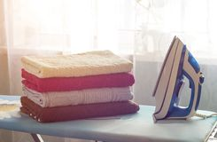Iron, ironing board and towels stock photos
