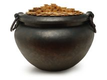 Iron kettle filled with gold. Coins on white Stock Image