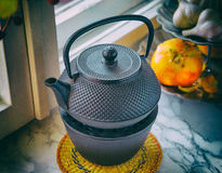 Iron kettle, photo in old style image. Stock Image