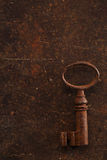 Iron key on metal backdrop Royalty Free Stock Image