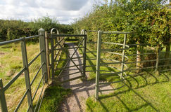 Iron kissing gate in good condition. Type of stile style. Stock Photo
