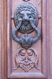 Iron Knocker on a Wooden Door Royalty Free Stock Images