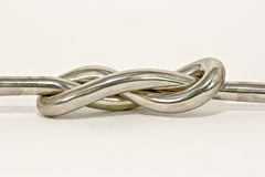 Iron knot. Sturdy knot of iron rod closeup Royalty Free Stock Image
