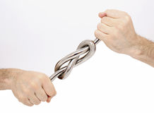 Iron knot in male hands Stock Photo