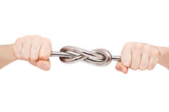 Iron knot in male hands Stock Photography