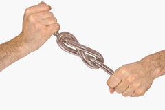 Iron knot in mans hands. Closeup isolated Stock Photos