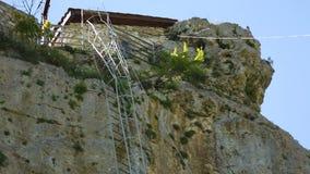 Iron ladder on Katskhi Pillar with ancient church on top in Chiatura, Georgia stock video